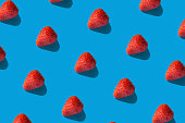 Colorful pattern of strawberries on blue background. high resolution