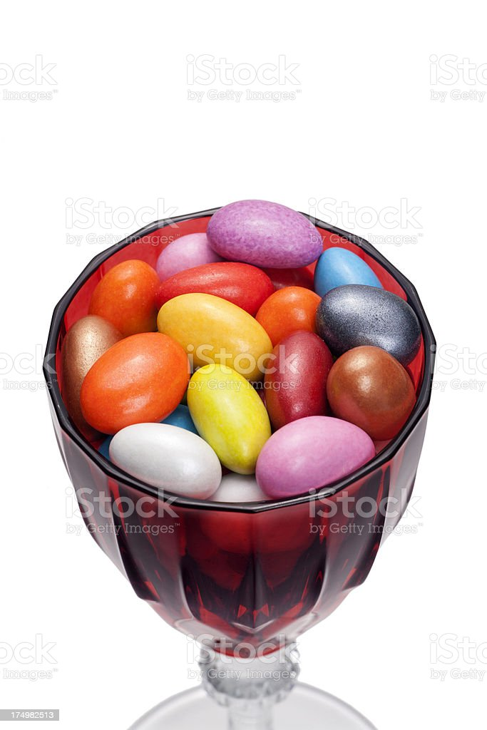 Colorful Peanut Candies In Red Wineglass royalty-free stock photo