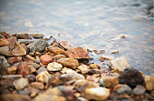 colorful pebble, clear water with gravel at side of the lake, imafe for background,wallpaper, copy space