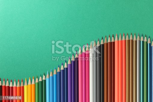 Color pencils isolated on colorful paper