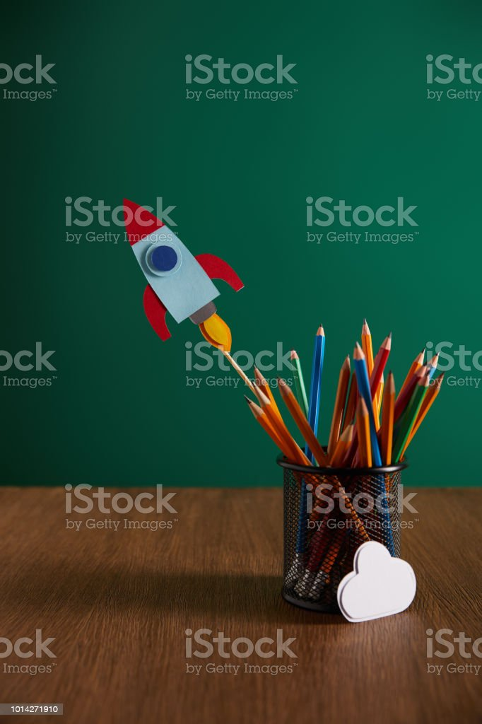 Colorful Pencils Rocket Cloud Sign On Wooden Table With Chalkboard