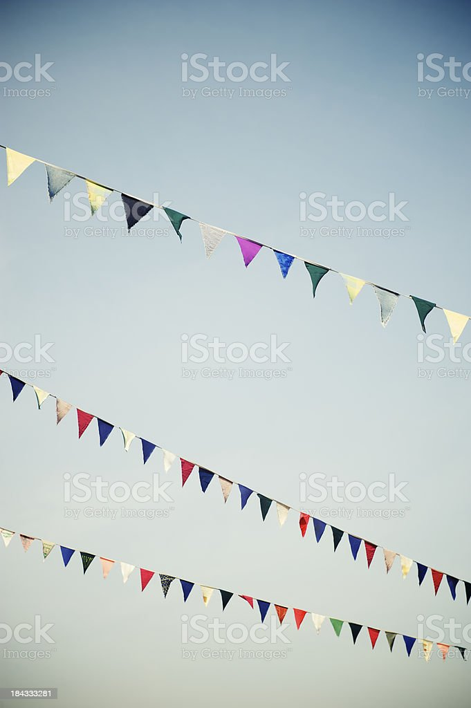 Colorful Pennant Flags Fly Across Clear Sky royalty-free stock photo