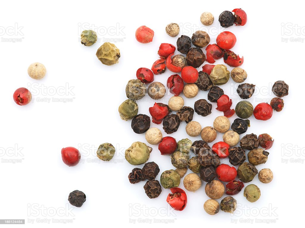 Colorful peppercorns on a white background stock photo