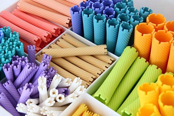 colorful permanent curler - dauerwelle stock-fotos und bilder