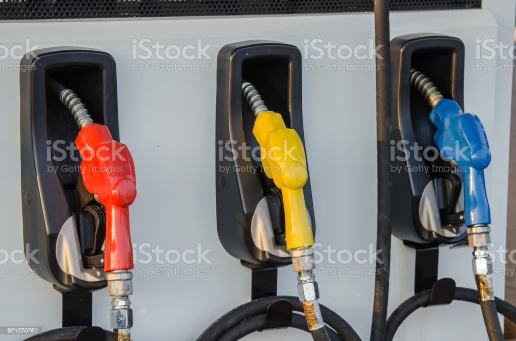 Colorful Petrol pump filling nozzles  , Gas station in a service stock photo