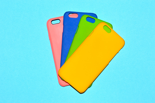 Colorful phone cases isolated on blue background
