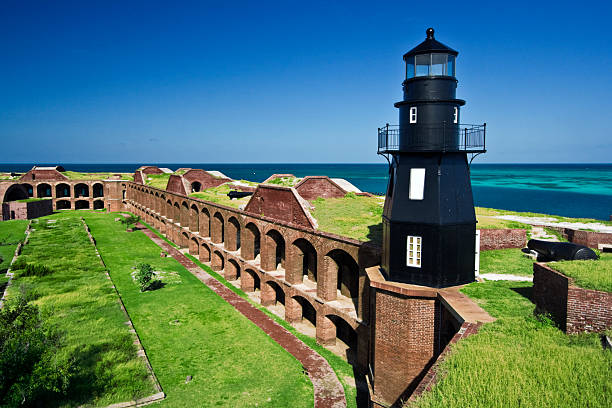 Colorful photo of the lighthouse and ruins of Ft Jefferson stock photo