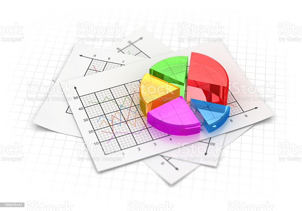 A colorful pie chart against a pile of graphs royalty-free stock photo