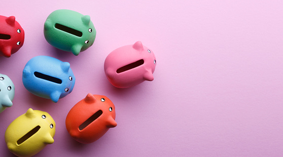 Top view of piggy banks over pink background.