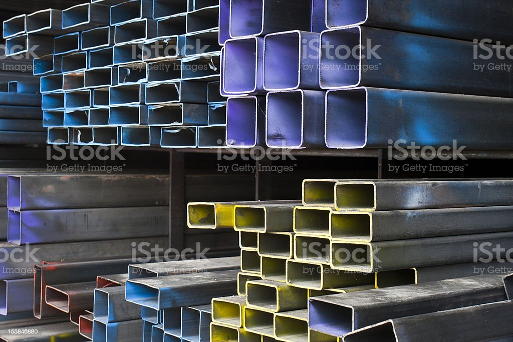 Colorful pile of metal tubes in warehouse royalty-free stock photo