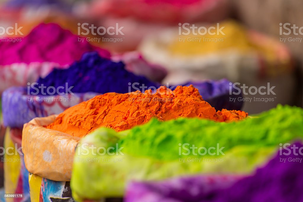 Colorful piles of powdered dyes used for Holi festival stock photo