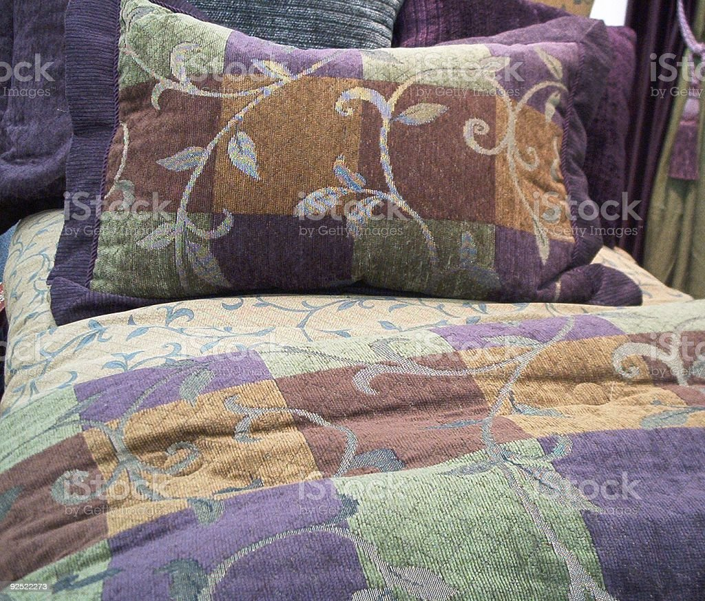 Colorful Pillow and Bed Spread royalty-free stock photo