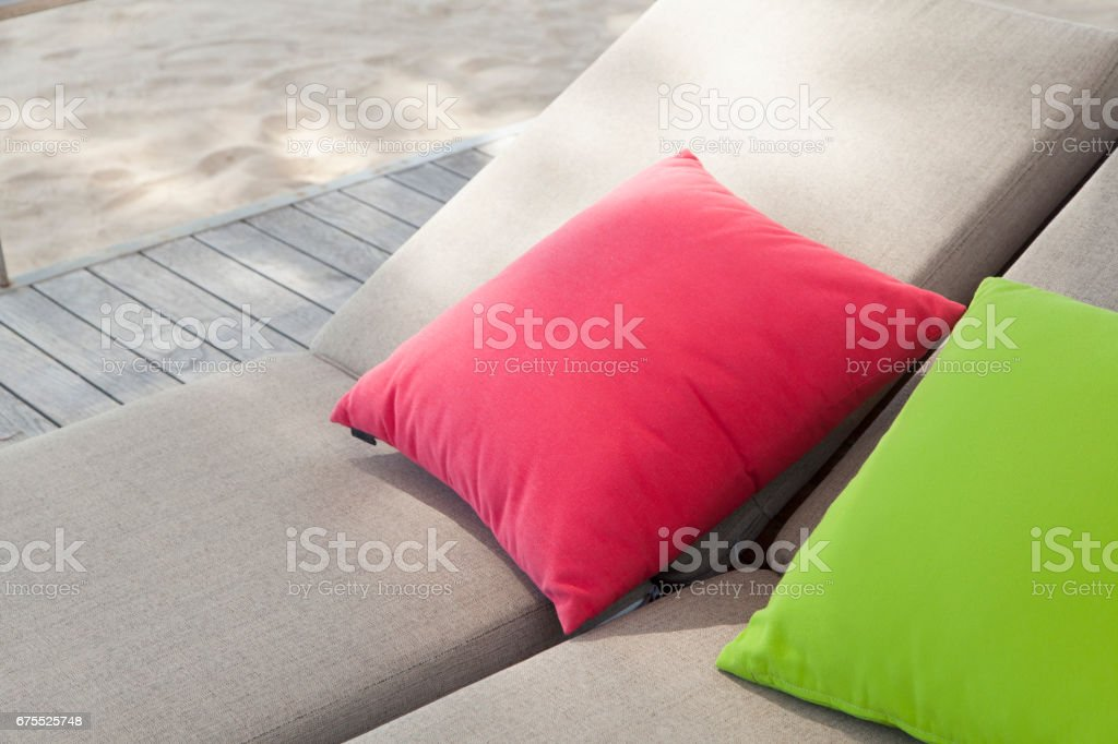 colorful pillow on daybed stock photo