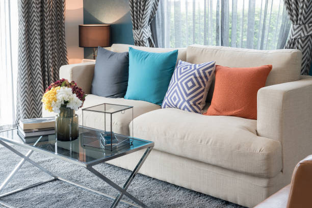 colorful pillows on modern sofa in modern living room stock photo