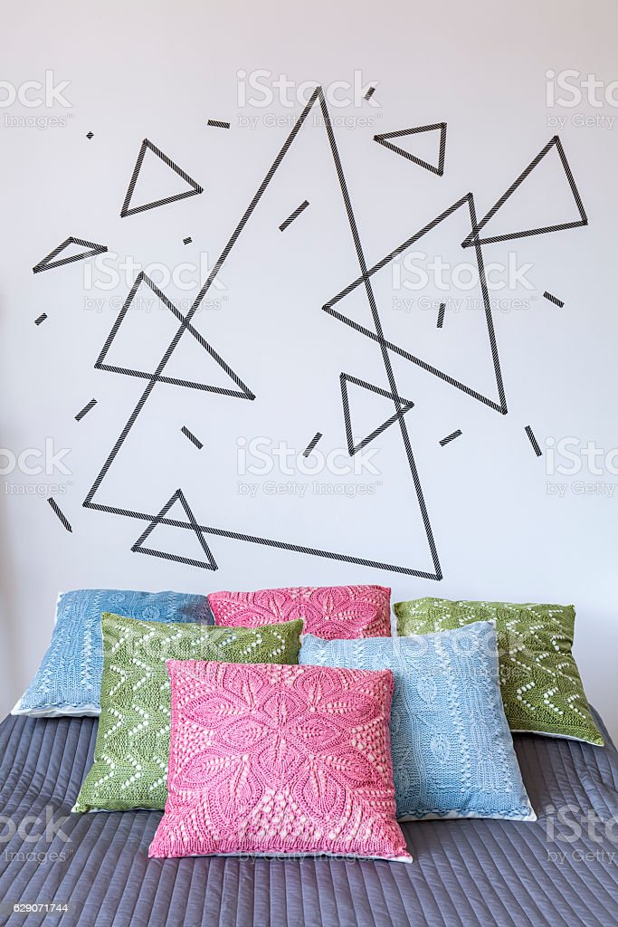 Colorful pillows on wide bed stock photo