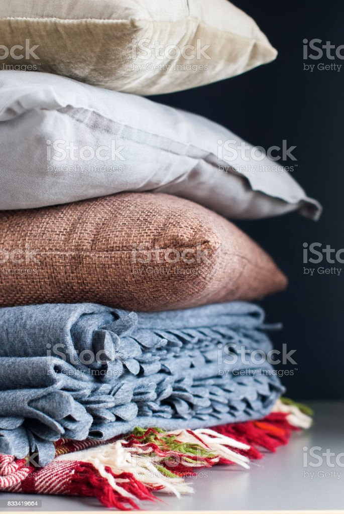 Colorful Pillows Stack on Black Background stock photo