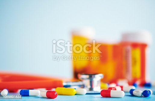 Colorful pills with stethoscope and pill bottles