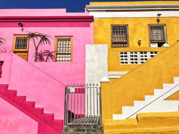 Colorful pink and yellow houses in Bo - Kaap ( Malay Quarter ) , Cape Town , South Africa stock photo