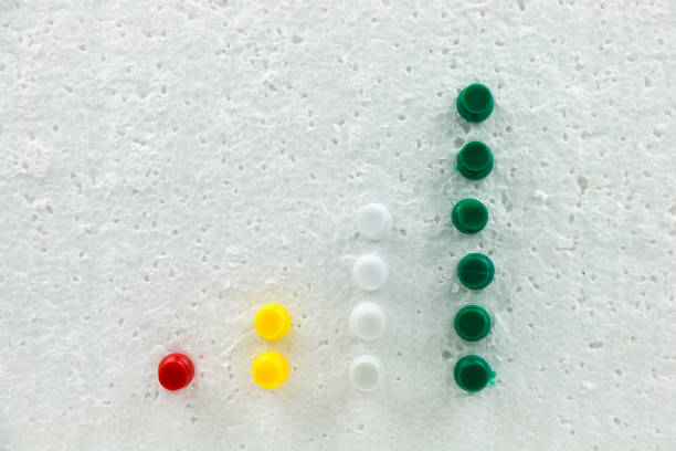 Colorful pins on polystyrene business growth chart. stock photo