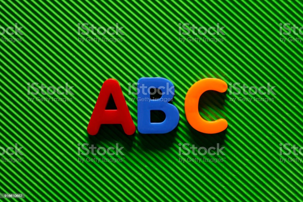 Colorful plastic alphabet letters on a blue stock photo more alphabet alphabetical order letter orthographic symbol periodic table urtaz Image collections