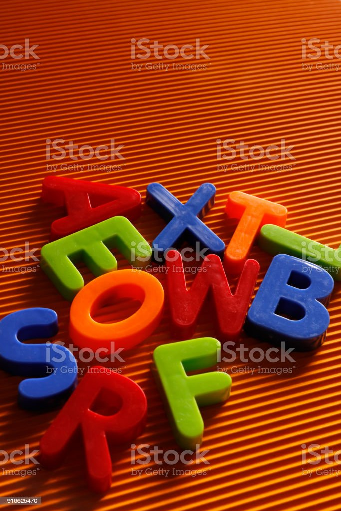 Colorful plastic alphabet letters on orange background stock photo alphabet alphabetical order letter orthographic symbol periodic table urtaz Image collections
