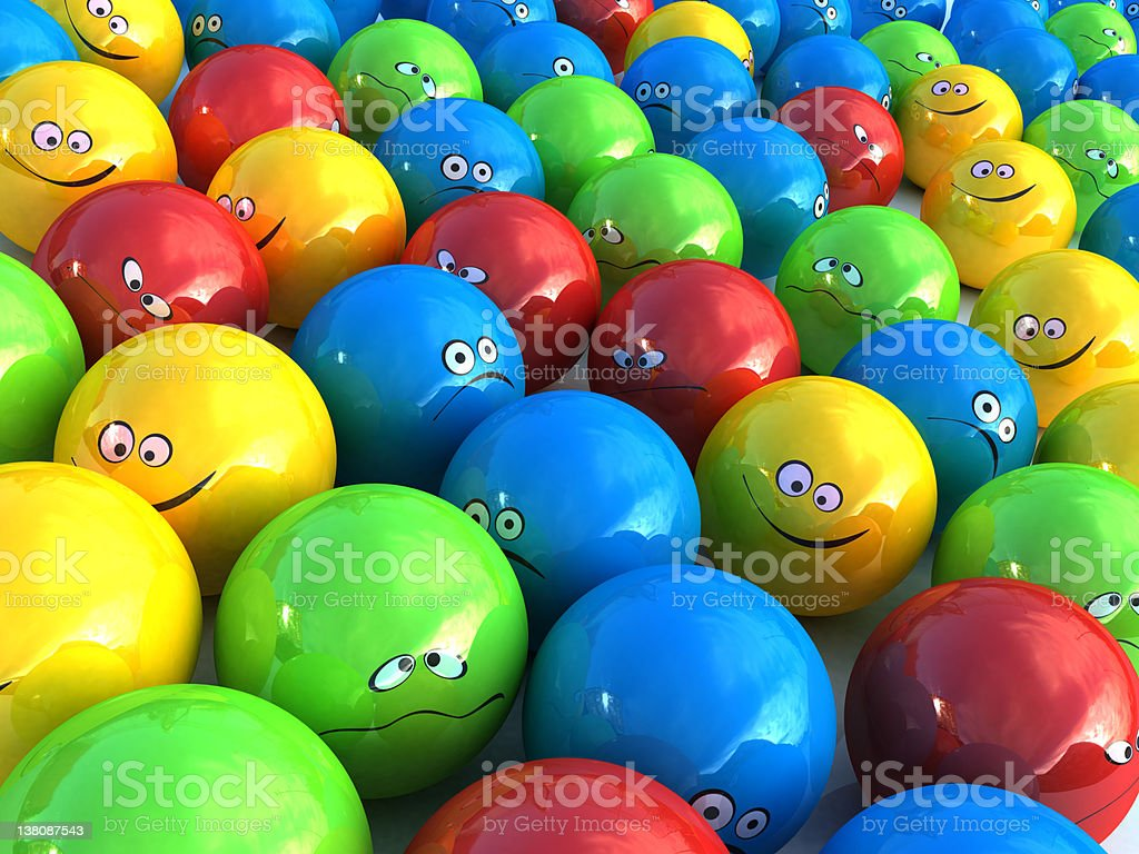 Colorful plastic balls with emotion faces royalty-free stock photo