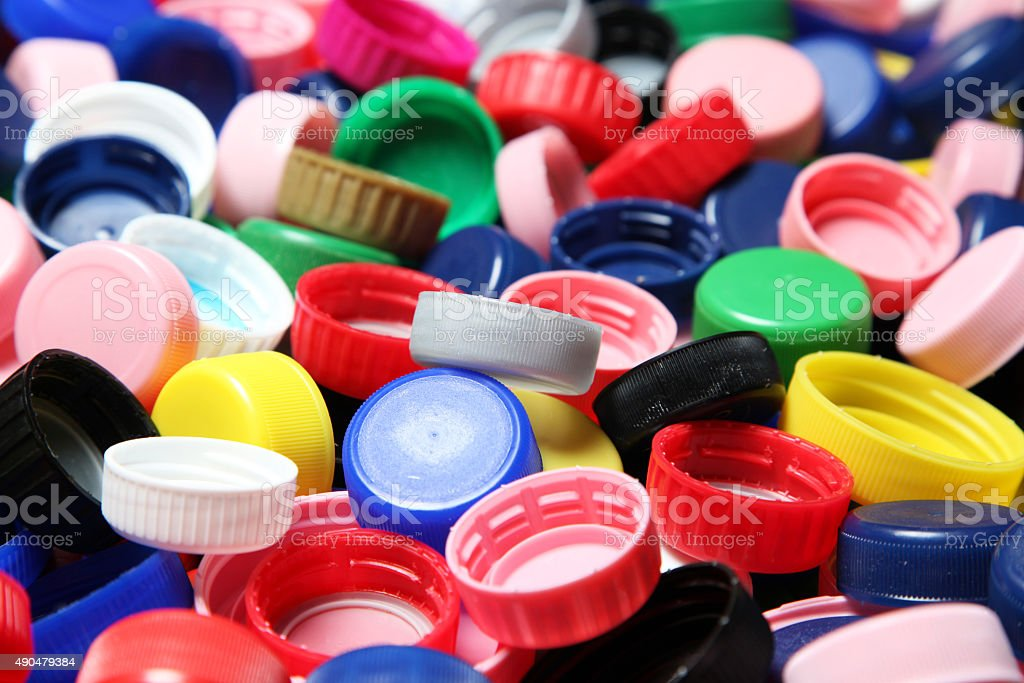 Colorful plastic caps background stock photo