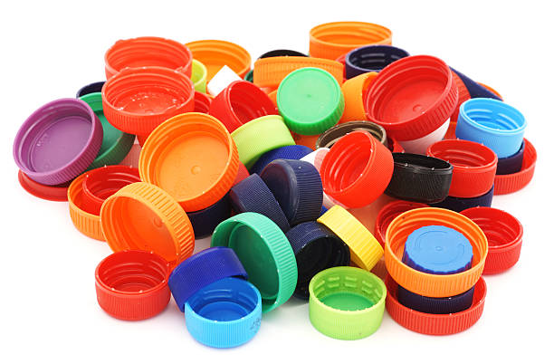 colorful plastic caps pile isolated in white - plastic cap stock pictures, royalty-free photos & images
