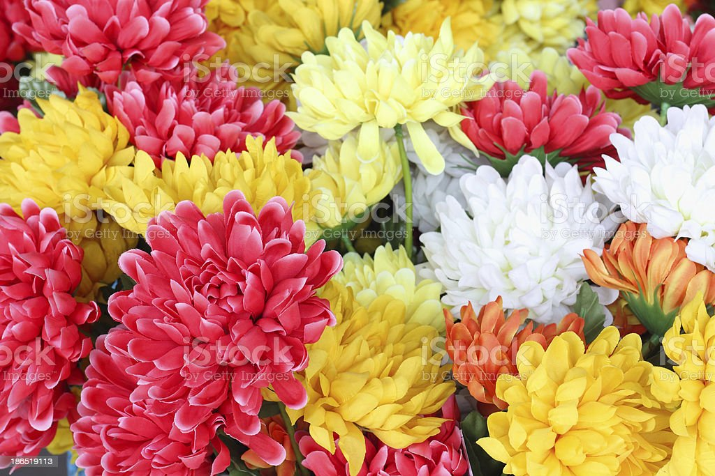 Colorful plastic fake flowers royalty-free stock photo