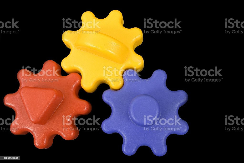 Colorful plastic gear-wheels stock photo