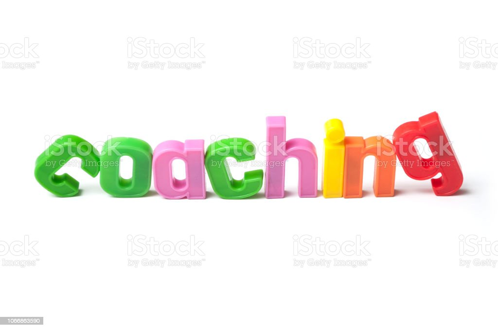 colorful plastic letters on white background - Coaching stock photo