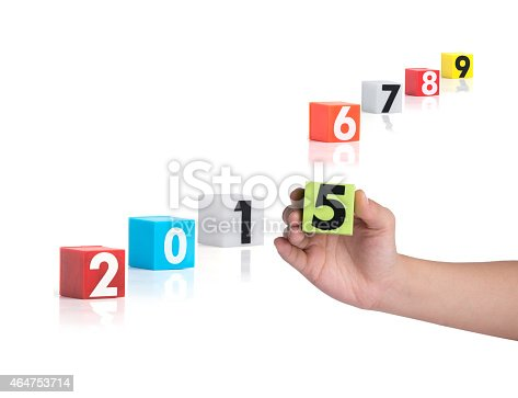 istock Colorful plastic of year numbers on a white background 464753714