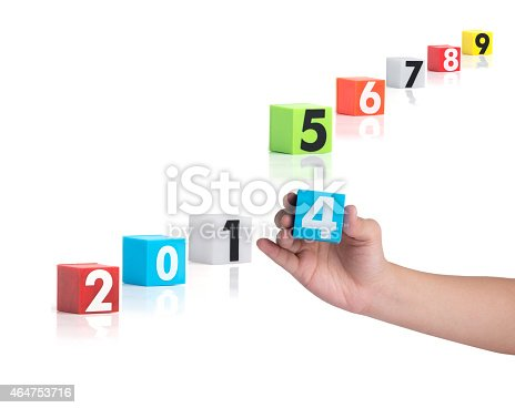 istock Colorful plastic of year numbers on a white background 464753716