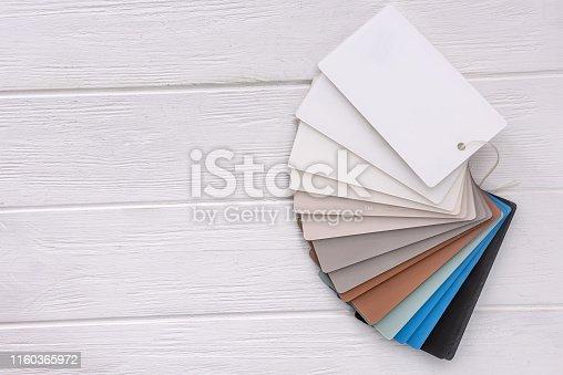 istock Colorful plastic sampler on light wooden background 1160365972