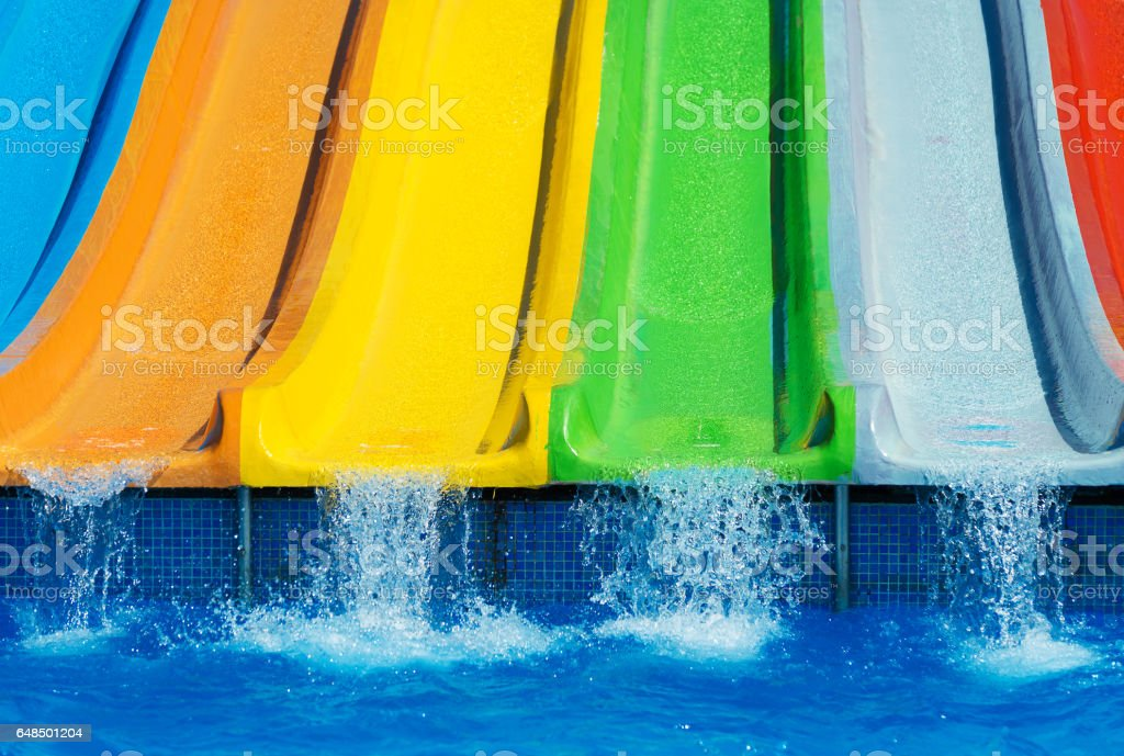 Colorful plastic water-slides in aqua park. – Foto
