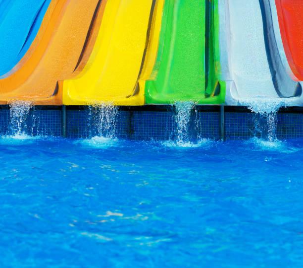 Colorful plastic water-slides in aqua park. stock photo
