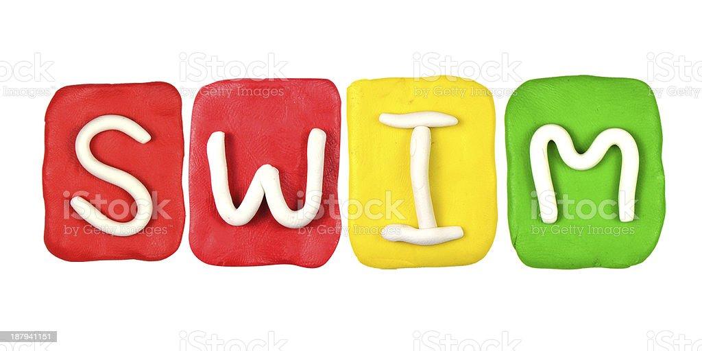 Colorful plasticine alphabet form word SWIM royalty-free stock photo