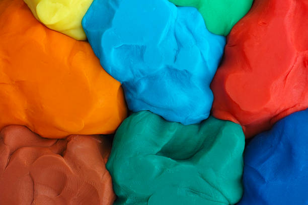 Colorful plasticine texture Colorful plasticine texture. Close up. clay stock pictures, royalty-free photos & images