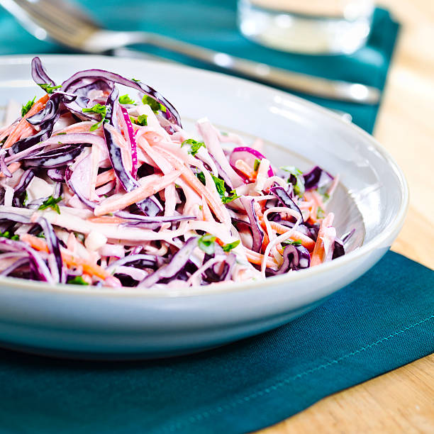 a colorful plate of coleslaw salad - coleslaw stock pictures, royalty-free photos & images