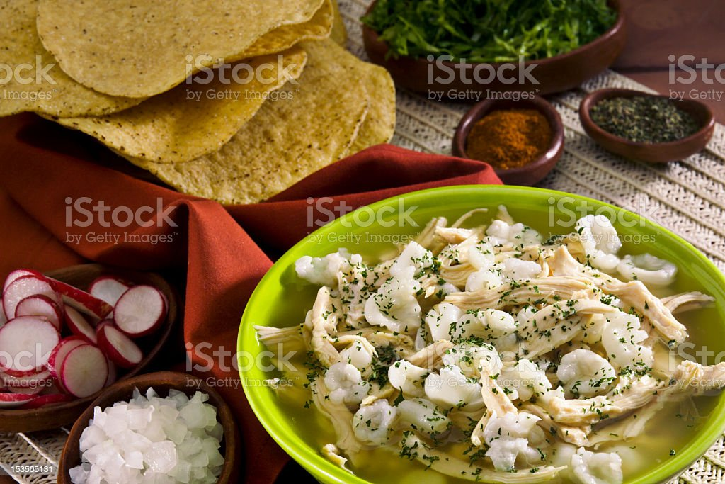 Colorful plate of Mexican white pozole served with tortillas stock photo