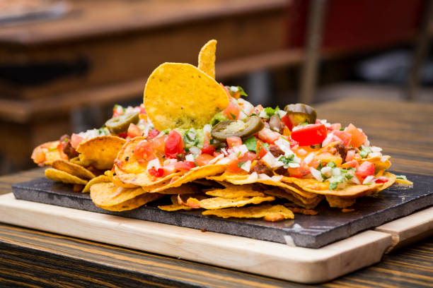 Colorful plate of nachos flavored with vegetables stock photo