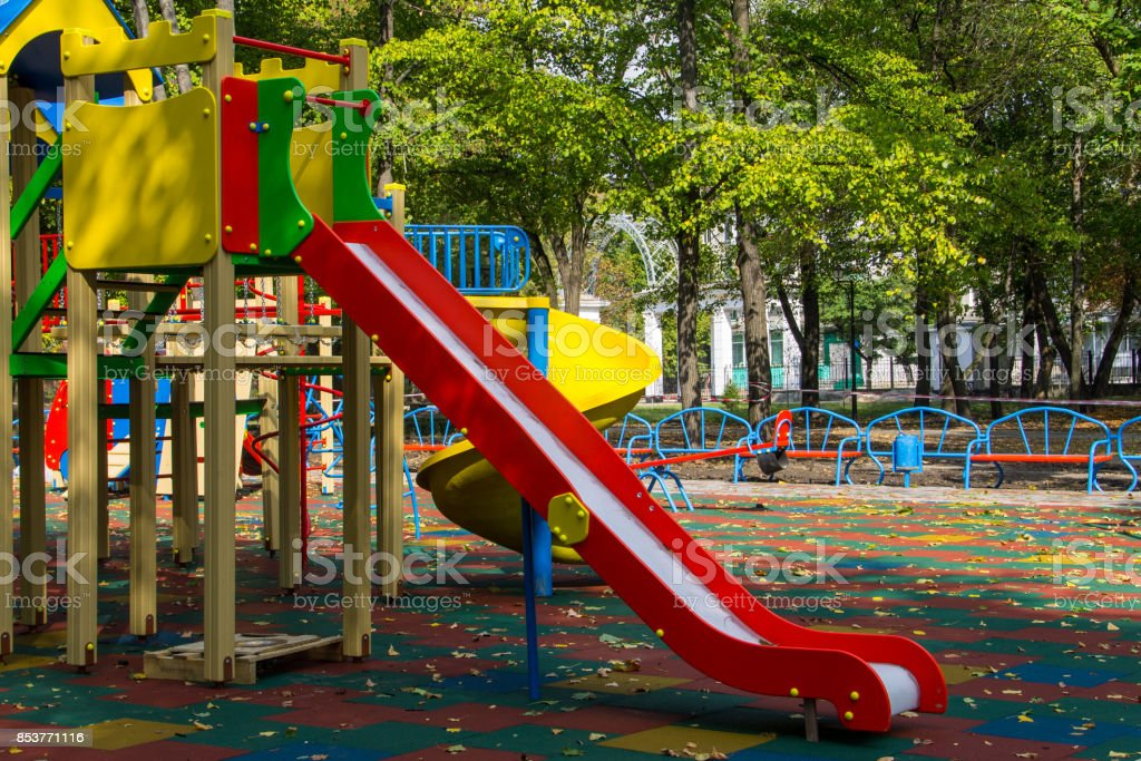Colorful playground equipment for children in public park stock photo