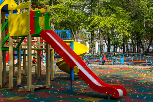 colorful playground equipment for children in public park - recess stock photos and pictures