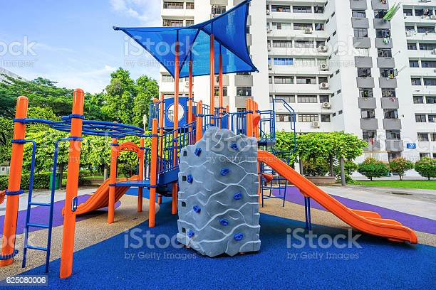 Colorful playground on yard at hdb apartment in singapore picture id625080006?b=1&k=6&m=625080006&s=612x612&h=pkdo8dyozv6axnf4d4dgor4 twdnat0anju8mxuvbci=