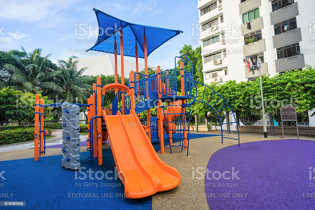 Colorful playground on yard at HDB apartment in Singapore stock photo