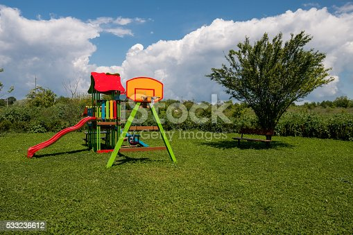 656743520istockphoto Colorful playground on yard in the park. 533236612