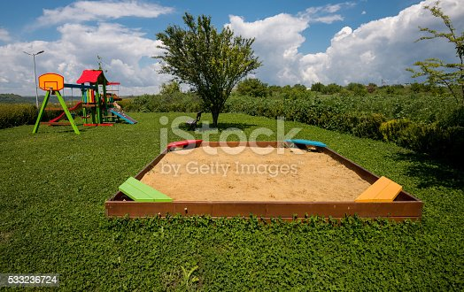 656743520istockphoto Colorful playground on yard in the park. 533236724