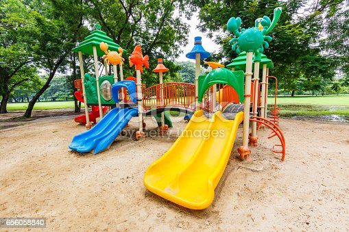 656743520istockphoto Colorful playground on yard in the park. 656058840