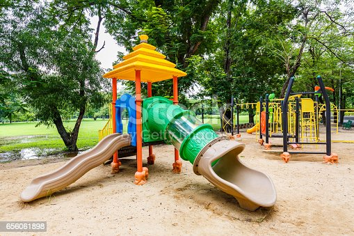 656743520istockphoto Colorful playground on yard in the park. 656061898