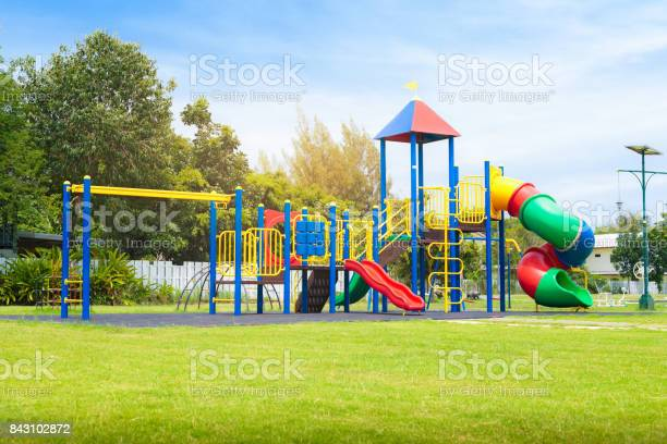 Colorful Playground On Yard In The Park Stock Photo - Download Image Now